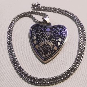 Black cat planchet necklace